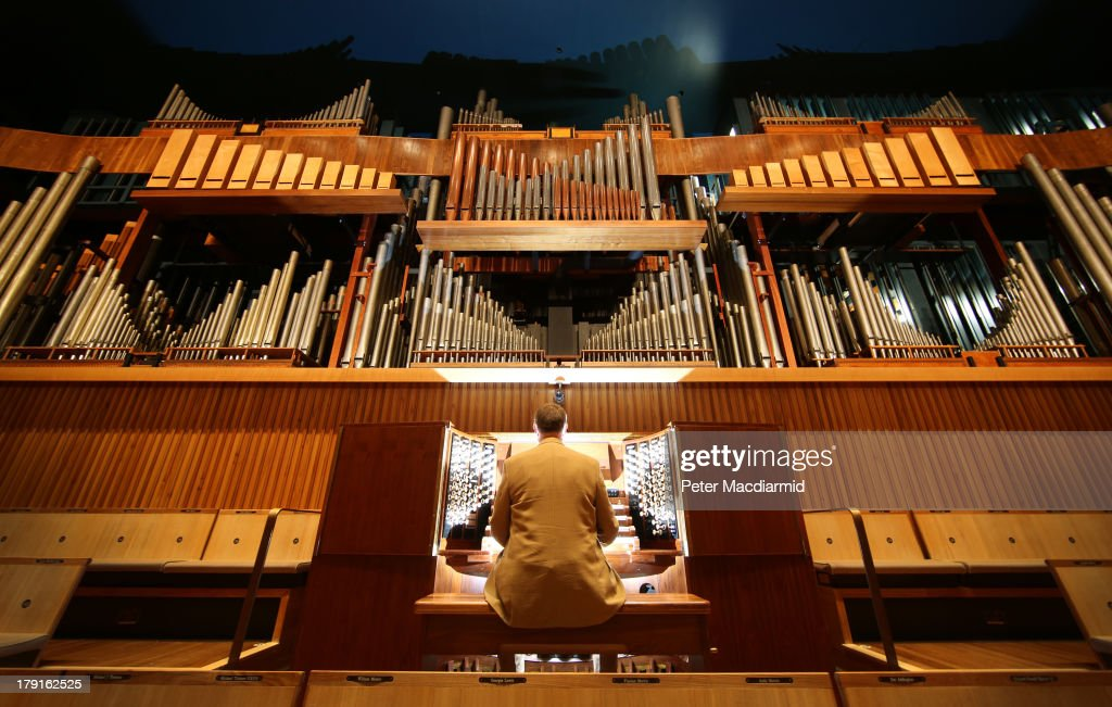 Organ Curator Dr William McVicker sits at the console of the Royal Festival Hall organ at Southbank Centre on August 30, 2013 in London, England. Recently unveiled following its restoration and re-installation by organ builders Harrison & Harrison at a cost of £2.3 million raised through donations from 60,000 people and a grant from the Heritage Lottery Fund. The instrument, comprising 7,866 pipes, will now be voiced and balanced ahead of its re-inauguration at the Pull Out All The Stops organ festival, running from March 18, 2014 to June 7, 2014. The festival also marks the organs 60th anniversary since it was first played in May 1954.