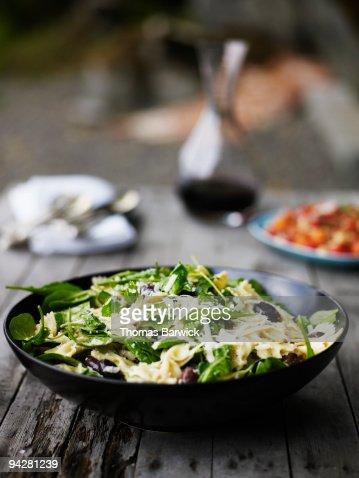 Organic arugula  and bowtie salad  : Stock Photo