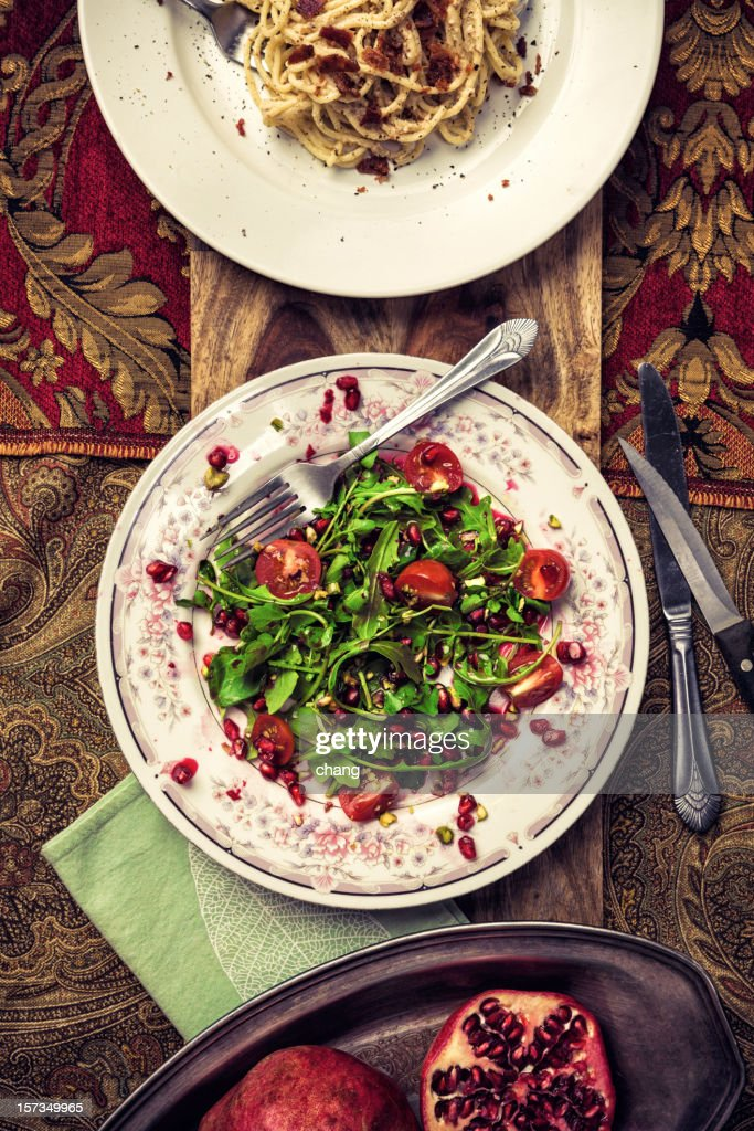 Organic Arugula Pomegranate Salad and Spaghetti Carbonara : Stock Photo
