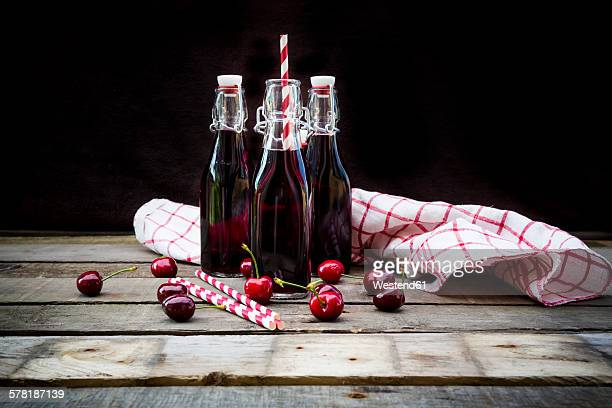 Organic cherry juice in bottles