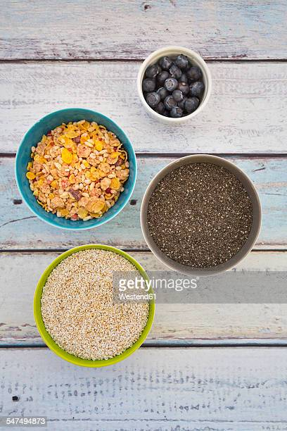 Organic chia seeds and popped amaranth, blueberries and glutenfree cereal in bowls