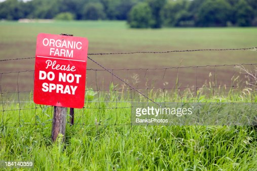Organic Farm Sign at the edge of a Field