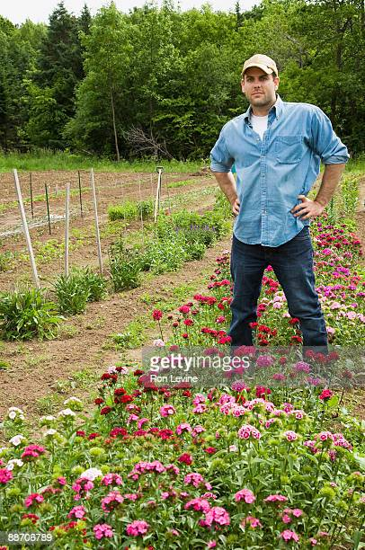 Organic farm worker and flower bed