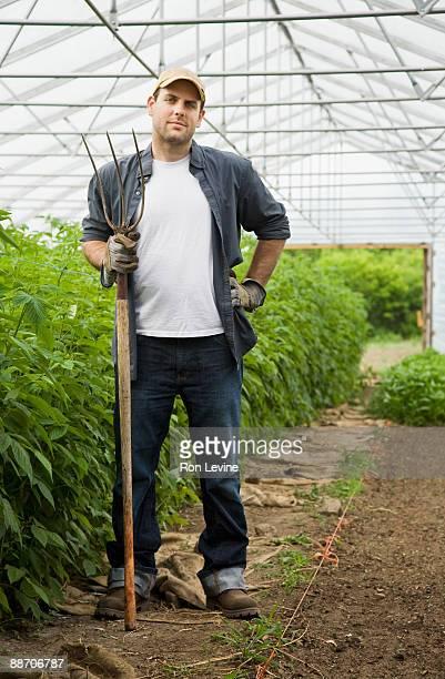 Organic farm worker in greenhouse, portrait