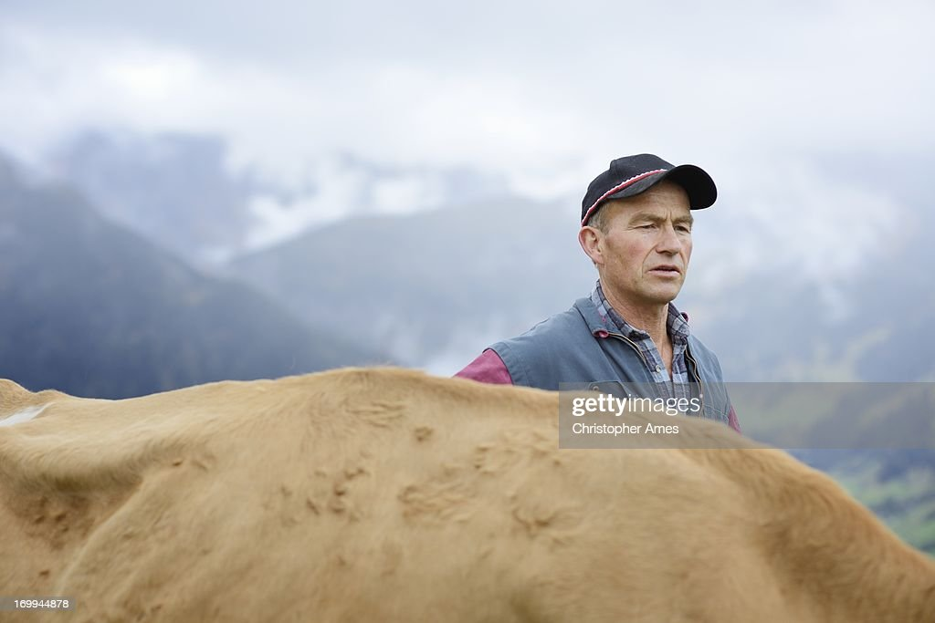 Organic Farmer with Cow