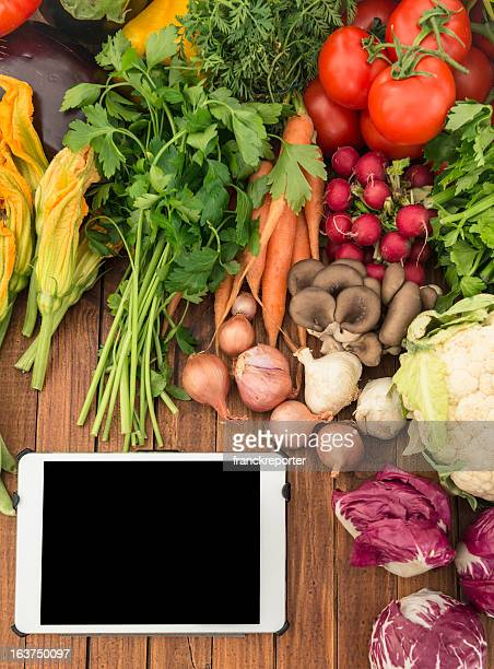 organic food mix with digital tablet