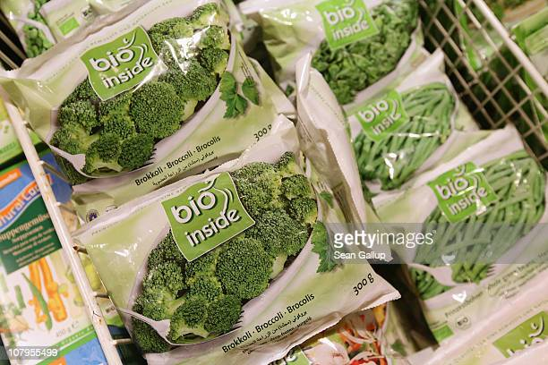 Organic frozen broccoli beans and other vegetables lie in a refrigerator display at a branch of German organic grocery store chain Bio Company on...