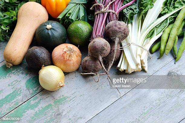 Organic fruit & vegetables on a wooden surface