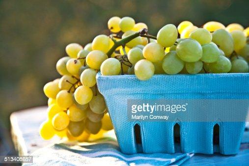 Organic green grapes in basket