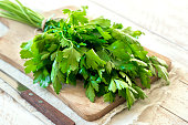 Organic italian parsley closeup on rustic wooden table, healthy vegetarian food