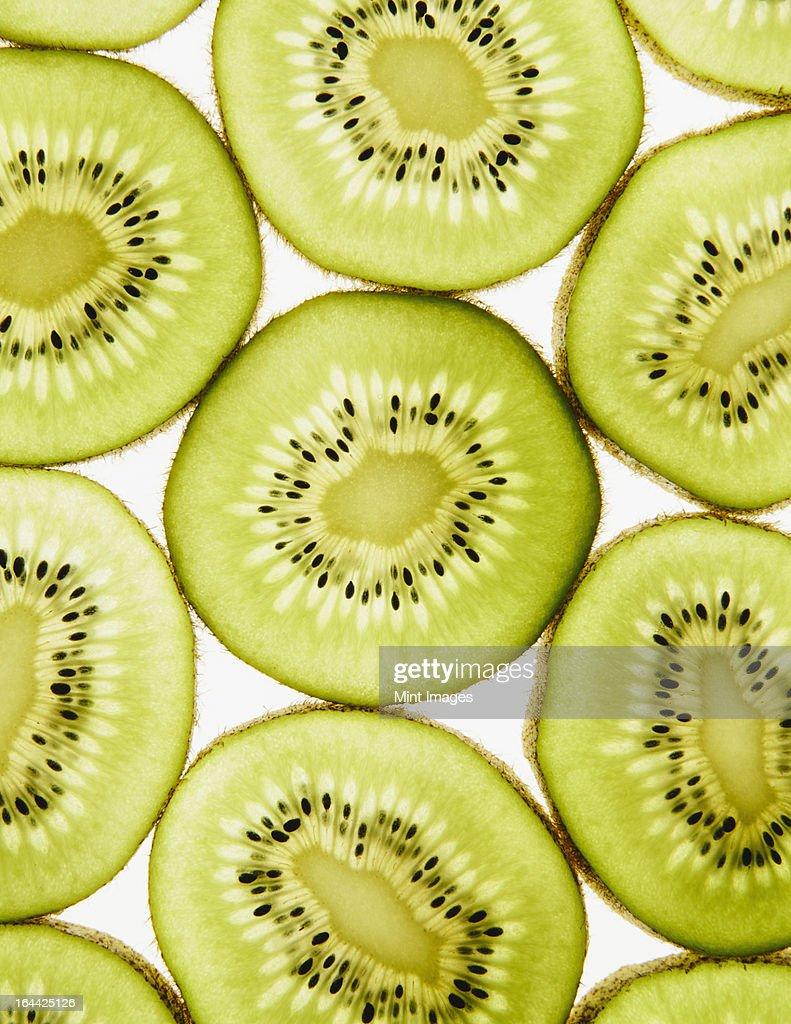 Organic kiwi slices, white background