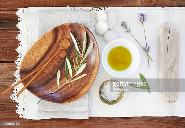 Organic oil and salt with lavender on table cloth