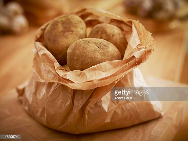 Organic potatoes in paper bag