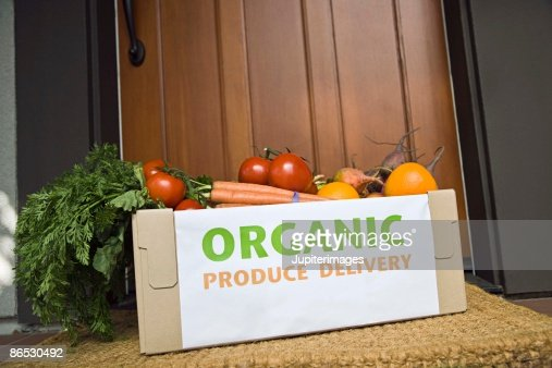 Organic produce on porch : Stock Photo