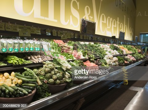 Organic produce section in grocery store : Stock Photo