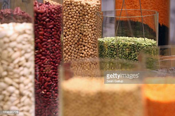 Organic pulses including lentils and beans lie in glass cylinders on display at the 2013 Gruene Woche agricultural trade fair on January 18 2013 in...