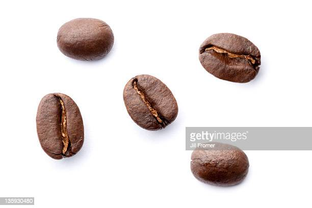 Organic roasted coffee beans on white background