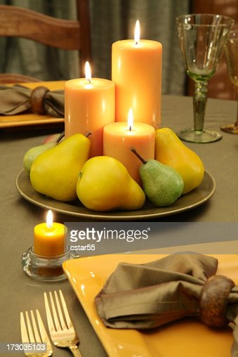 Organic table setting and Decoration with candles and fruit