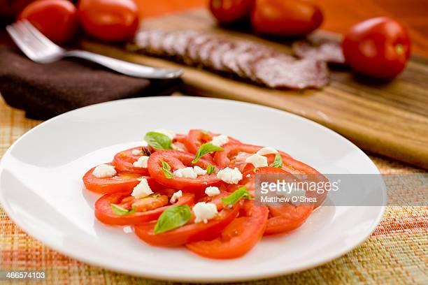 Organic tomato salad with goat cheese & micro basi