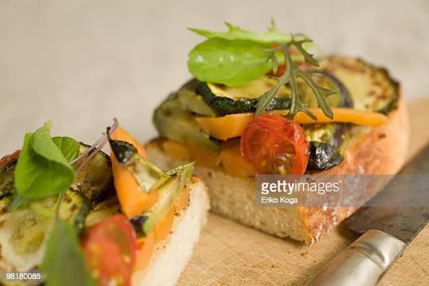 Organic vegetable open sandwiches cut in half