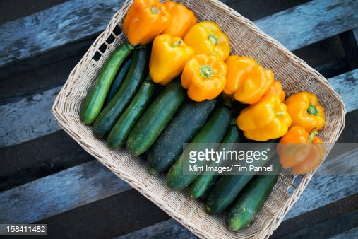 Organic Zucchini in basket with Yellow and Orange Bell Peppers : Stock Photo