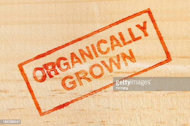 Organically Grown Rubber Stamp Impression on Wood Background Vt