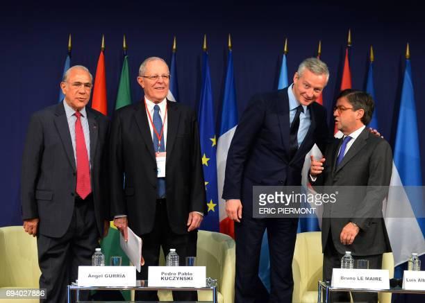 Organisation for Economic Cooperation and Development General Secretary Angel Gurria Peruvian President Pedro Pablo Kuczynski French Economy Minister...