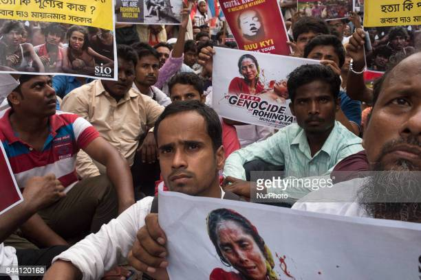SOI Organisation's members protest on the roads of Kolkata with their placards and slogans against the barbaric mass killings of Rohingya Muslims in...