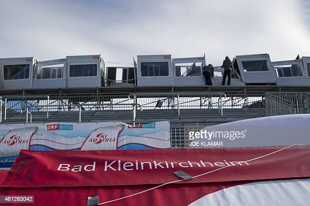 Organisers check for damages in the finish area and the course of the cancelled women's World Cup downhill event of the FIS Ski World Cup in Bad...