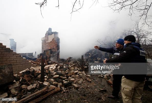 Organization for Security and Cooperation in Europe observers inspect the fire site caused by proRussian separatists' shellings at Avdeevka district...