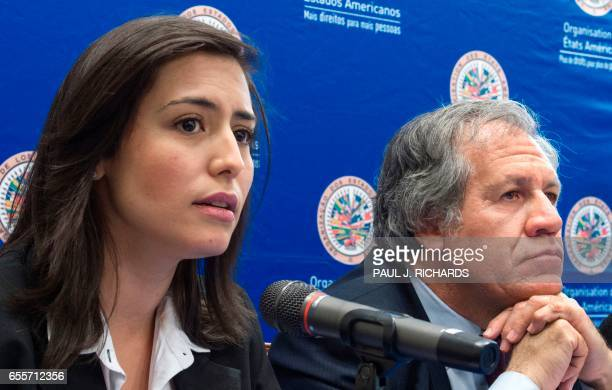Organization of American States Secretary General Luis Almagro listens as wives of Venezuelan political prisoners hold a press conference March 20...