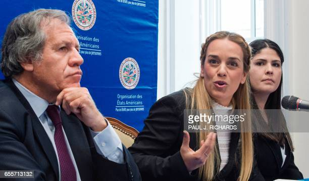 Organization of American States Secretary General Luis Almagro listens as wife of Venezuelan political prisoners Lilian Tintori speaks as Oriana...