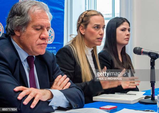 Organization of American States Secretary General Luis Almagro listens as wife of Venezuelan political prisoner Lilian Tintori speaks and Oriana...