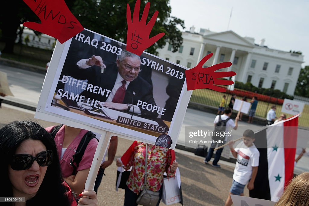 Organized by the Syrian American Forum (SAF), demonstrators protest against a possible military attack on Syria by the United States outside the White House September 9, 2013 in Washington, DC. The SAF is an independent, not-for-profit organization working 'to educate the Syrian American community and the general public as to political, social and economic events occurring in the United States and Syria.'