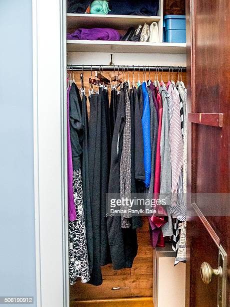 Organized small women's clothes closet