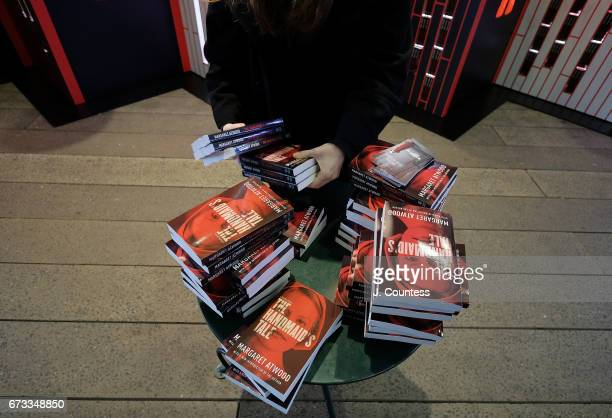 Organizers arrange copies of Margaret Atwood's book 'The Handmaid's Tale' during the Interactive 'The Handmaid's Tale' Art Installation Opening at...
