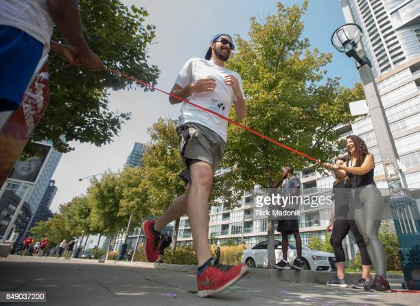 Organizers at this site tried to string a red ribbon for runners to tear through once finished The annual Terry Fox run was held today across Canada...