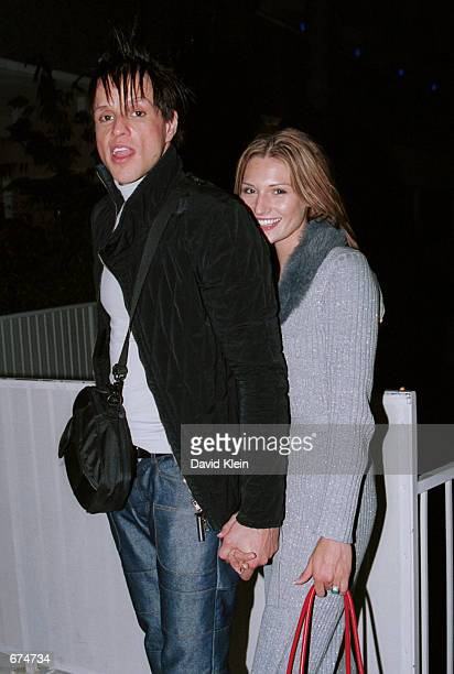 Orgy lead singer Jay Gordon pose with his girlfriend Andrea outside The Standard hotel November 29 2001 in West Hollywood CA