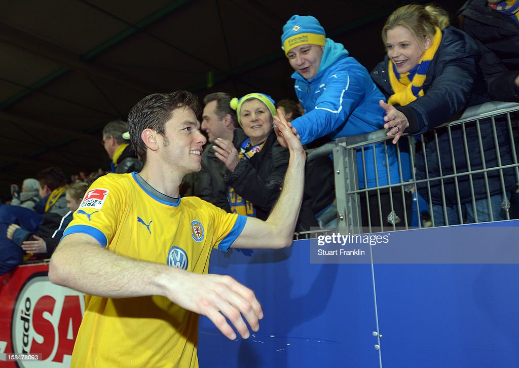 Orhan Ademi of Braunschweig celebrates with the fans at the end of the Second Bundesliga match between Eintracht Braunschweig and1. FC Union Berlin at the eintracht stadium on December 17, 2012 in Braunschweig, Germany.