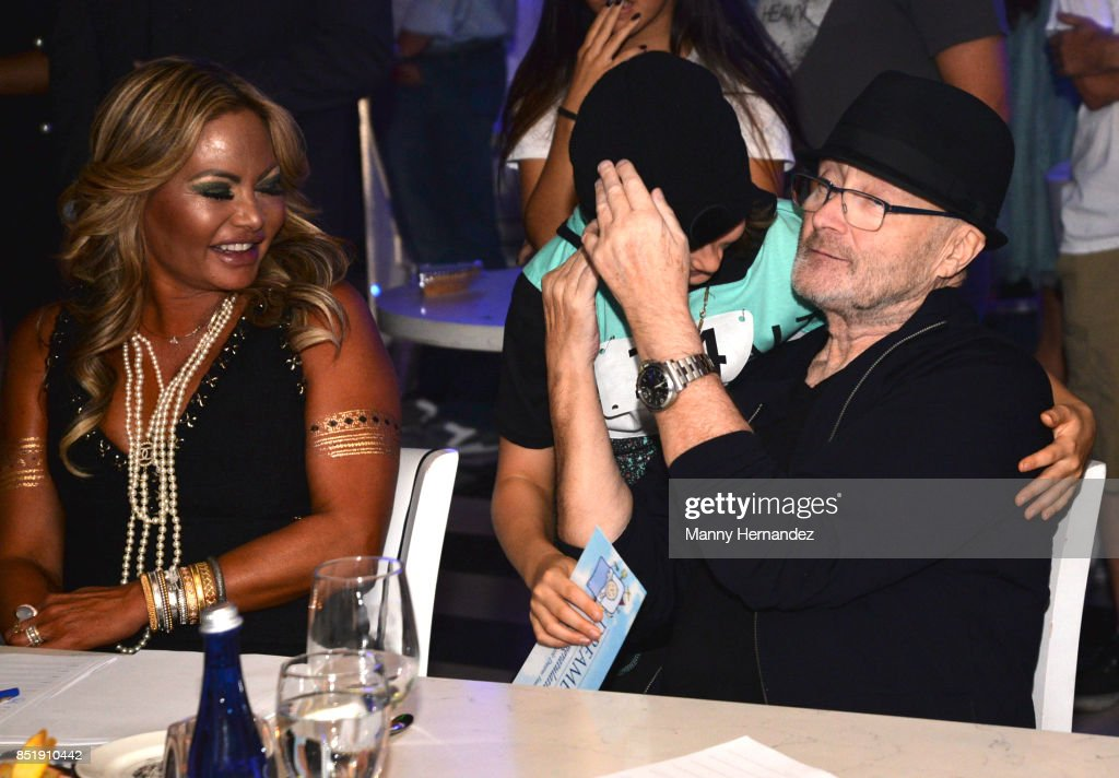 Orianne Collins, Phil Collins with fan attends Little Dreams Foundation Music Auditions in Design District on September 20, 2017 in Miami, Florida.