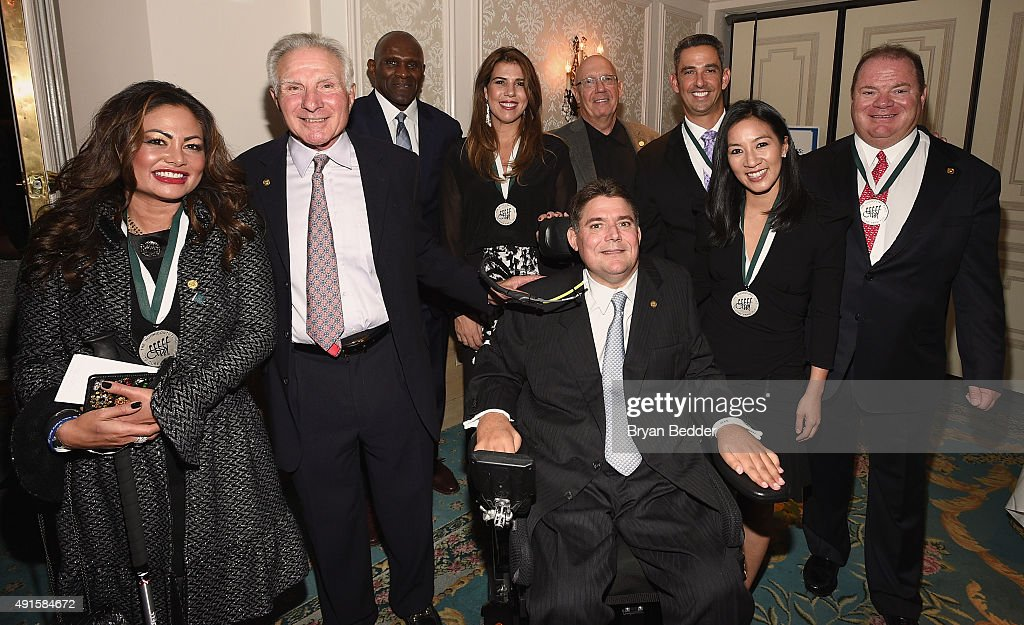 Orianne Collins-Mejjati, Nick Buoniconti, Harry Carson, Jennifer Capriati, Marc Buoniconti, Dann Florek Jorge Posada, Michelle Kwan and Chip Ganassi attend the 30th Annual Great Sports Legends Dinner to benefit The Buoniconti Fund to Cure Paralysis at The Waldorf Astoria on October 6, 2015 in New York City.