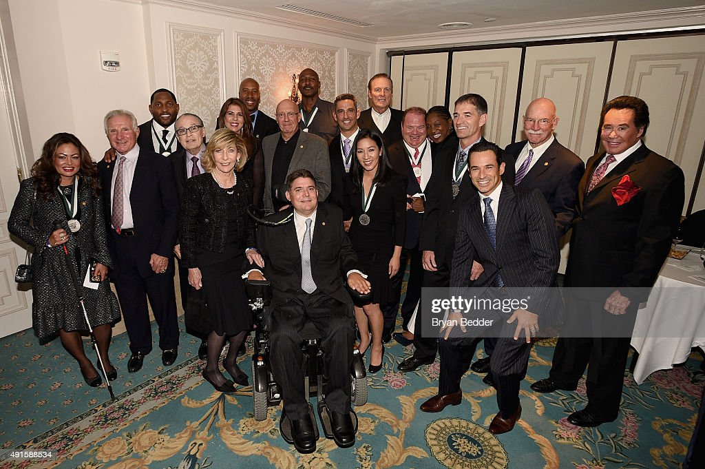 Orianne Collins-Mejjati, Ray Lewis, Dr. Barth A. Green, Terry Buoniconti, Harry Carson, Jennifer Capriati, Bruce Bowen, Dann Florek, Marc Buoniconti, Karl Malone, Jorge Posada, Michelle Kwan, Rick Barry, Chip Ganassi, Teresa Edwards, John Stockton, Helio Castroneves, and Wayne Newton attend the 30th Annual Great Sports Legends Dinner to benefit The Buoniconti Fund to Cure Paralysis at The Waldorf Astoria on October 6, 2015 in New York City.