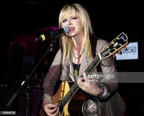 Orianthi performs at the grand opening of Hard Rock Cafe Hollywood on October 21 2010 in Hollywood California