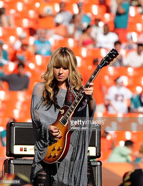 Orianthi performs during the halftime show at the Miami Dolphins game at Landshark Stadium on December 27 2009 in Miami Florida