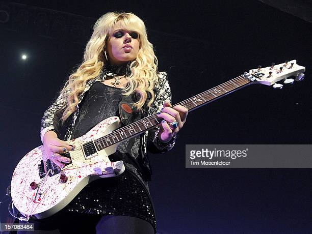 Orianthi performs with Alice Cooper at The Warfield on November 27 2012 in San Francisco California