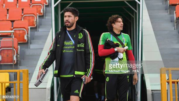 Oribe Peralta and Guillermo Ochoa look on during the Mexico training session on June 23 2017 in Kazan Russia