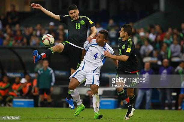 Oribe Peralta and Javier Hernandez of Mexico struggles for the ball with Henry Romero of El Salvador during the match between Mexico and El Salvador...