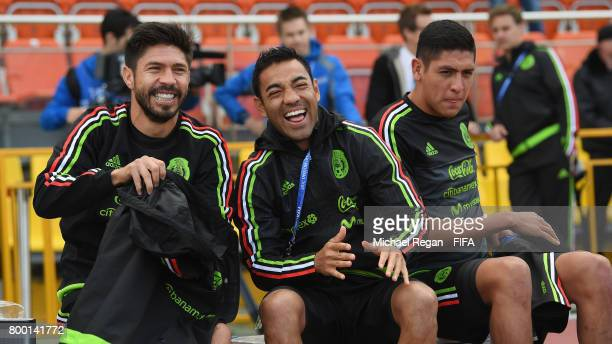 Oribe Peralta and Marco Fabian share a joke during the Mexico training session on June 23 2017 in Kazan Russia