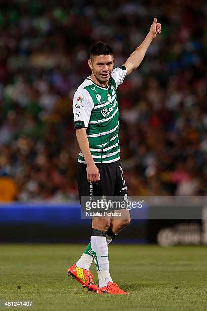 Oribe Peralta celebrates after scoring a goal during a match between Santos Laguna and Pumas UNAM as part of the 13th round of Clausura 2014 Liga MX...