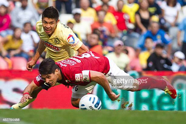 Oribe Peralta fights for the ball with Javier Güemez of Tijuana during a match between America and Tijuana as part of 2nd round Apertura 2014 Liga MX...